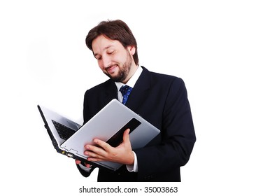 Young male standing with laptop as a book
