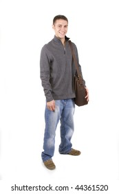 Young male student holding books in casual clothes.