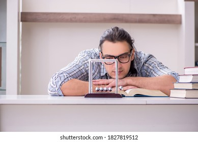 Young male student preparing for exam at home