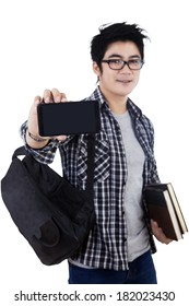 Young male student showing blank screen of mobile phone. isolated on white background