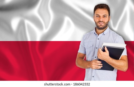 Young male student smiling over Polish flag.