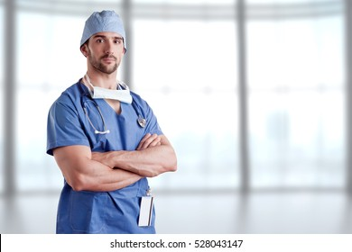 Young male surgeon with scrubs and a stethoscope