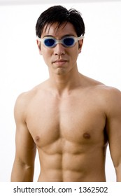 A young male swimmer in goggles