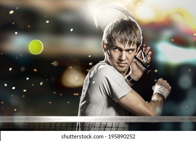 Young male tennis player hitting ball