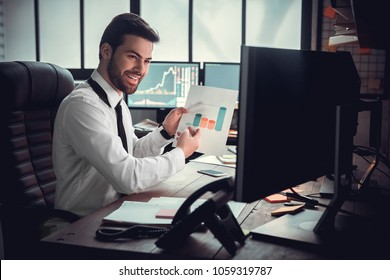 Young male trader at office work concept sitting in underwear having video call