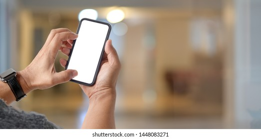 Young male using his smartphone in working space