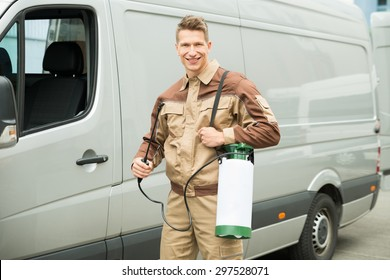 Young Male Worker With Pesticide Standing Near The Van