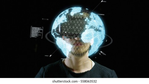 Young man with 3D virtual reality glasses enjoys his trip in an adventurous world on a dark background. Concept of connection technology with science, augmented future, global web