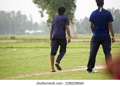Young man is about to deliver a white cricket ball isolated unique photo