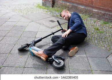 Young Man Accident With An Electric Scooter On Street