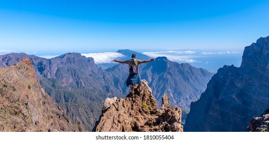 A young man after finishing the trek at the top of the volcano of Caldera de Taburiente near Roque de los Muchachos one summer afternoon, La Palma, Canary Islands. Spain