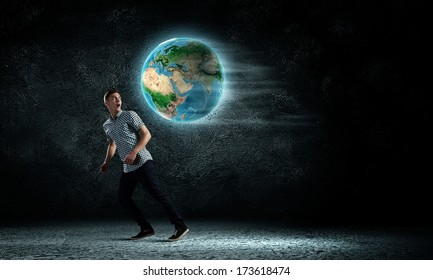 Young man against dark running from Earth planet. Elements of this image are furnished by NASA