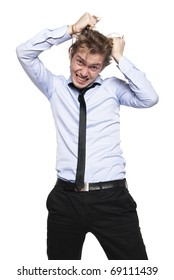 Young man so angry that he wants to pull his hair out. Studio photo, isolated on white.