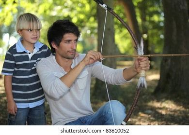 young man with archer and kid