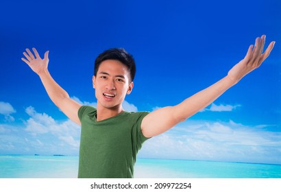 young man with the arms outstretched in outdoor
