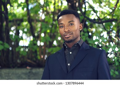 young man around twenty years old portrait outside