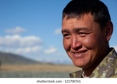 A young man of Asian appearance outdoors