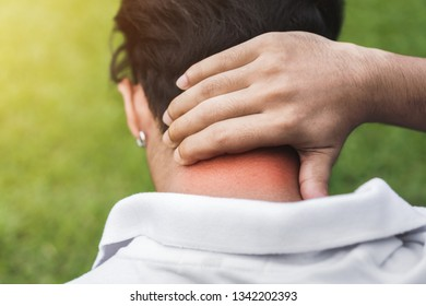 Young man asian have accident Neck pain in sport exercise jogging, Health and Fitness Concepts, Selective focus.