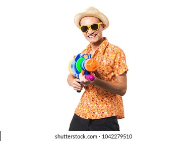 Young man Asian holding Songkran thailand festival gun water colorful on white background.