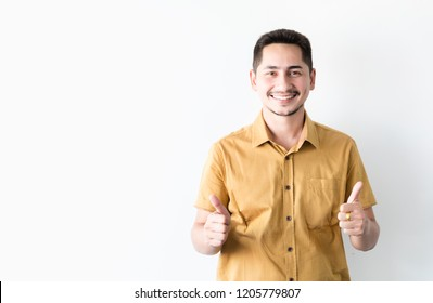 Young man asian smiling and looking at camera. Portrait of a happy handsome young man on white background. Young cool trendy man looking at camera and thumb up.