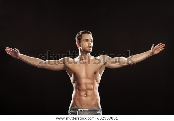 Young man athlet muscle body portrait in gym