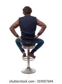 young man back with bar stool