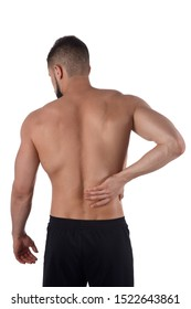 Young man with back pain. The athlete clings to a sore back. Man hurt his back. Sports medicine concept