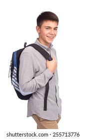 Young man with backpack posing in studio isolated