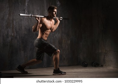 Young man with barbell flexing muscles and making shoulder press lunge in gym. Sport, bodybuilding, lifestyle and people photoshoot