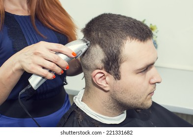 young man in a barber shaved shorn