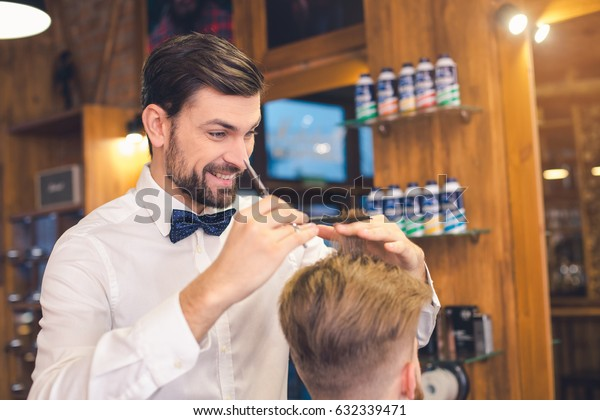 Young Man in Barber Shop Hair Care Service Concept