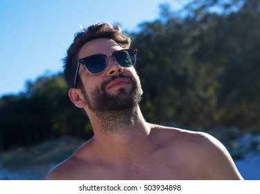 young man in the beach