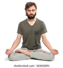 Young man with beard doing yoga on a white background