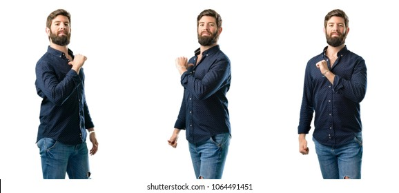 Young man with beard proud, excited and arrogant, pointing with victory face isolated over white background