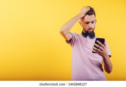 a young man with a bearded phone, astonished, angry and sad. With his hand in his head and his head. Place text and message