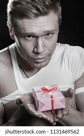 Young man with a beautiful gift in his hands