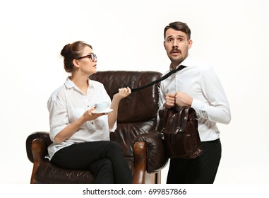 The young man and beautiful woman in business suit at office on white background