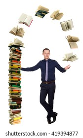 Young man and big pile of books, on white