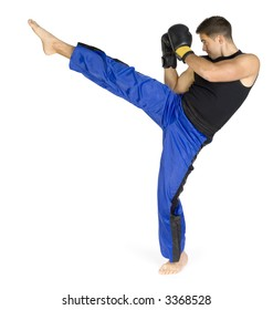 Young man in black boxing gloves doing flying kick. Isolated on white in studio. Whole body, standing backside.