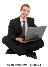 young man in a black business suit with a laptop on a white background