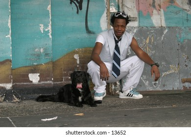 Young Man and black dog