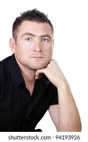 Young man in a black shirt, deep in thought on a white background