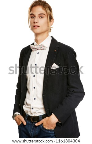 bcaef028af A young man in a black suit jacket and button up shirt, accessorized with a