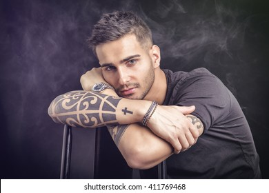 Young man with black t-shirt and tattoos
