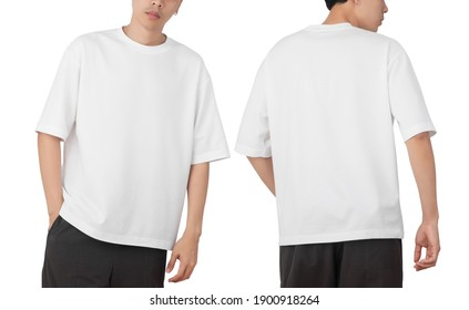 Young man in blank oversize t-shirt mockup front and back used as design template, isolated on white background with clipping path.