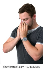 Young Man Blowing Nose into a tissue