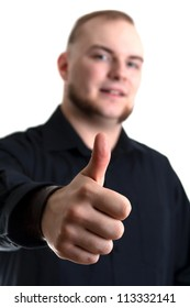 young man with blue eyes gives the thumbs up gesture on white background - Focus on his thumb