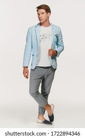 young man in a blue jacket posing in the studio