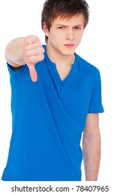 young man in blue t-shirt showing thumbs down. isolated on white background