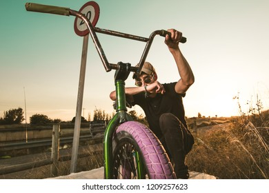 Young man with a bmx bike. BMX rider
